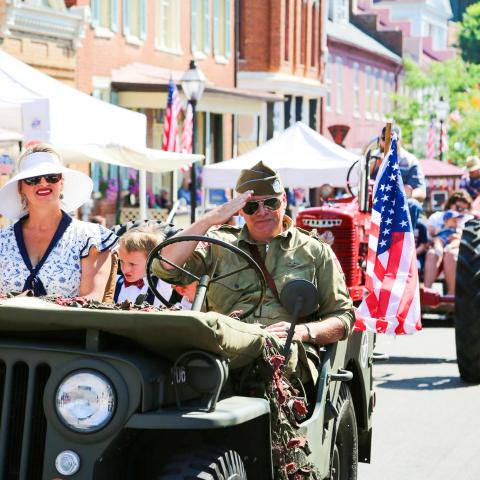 WWII historian rides in military jeep during Jonesborough Days Parade in Jonesborough, Tennessee