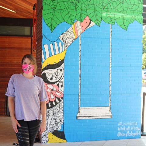 Kelsey Montague with her new mural in Nashville TN
