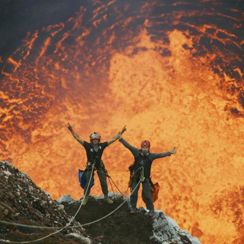 Two people repelling down the Marum Crater, an active volcano