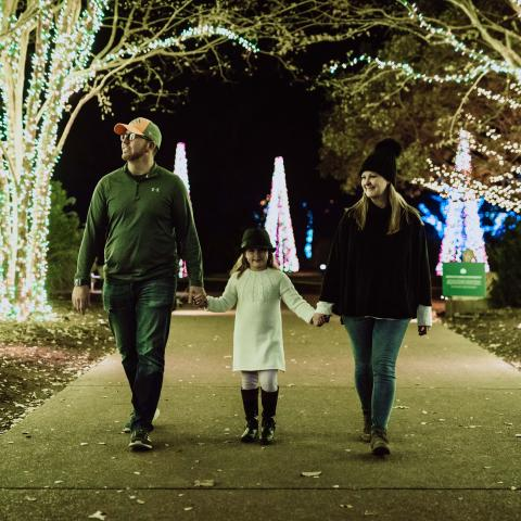 A family at Cheekwood's Holiday Lights in Nashville TN